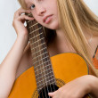 Teen girl playing guitar — Stock Photo