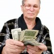 Happy old man holding dollars — Stock Photo #10175114