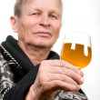 Elderly man with glass of wine — Stock fotografie