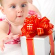 Reaching for gift box — Stock Photo