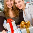 Girls delivering gifts — Stock Photo