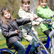 Girls on bicycles — Stock Photo