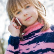 Little girl calling on cellphone — Stock Photo #10175186