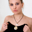 Pretty young woman with metal pendant — Stock Photo