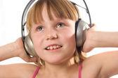 Piękna dziewczyna szczęśliwy słuchawki — Zdjęcie stockowe