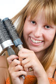 Blond teen girl with hair brushes — Stock Photo