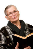 Elderly man reading a book — Stock Photo
