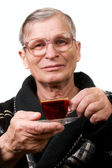Handsome elderly man drinking coffee — ストック写真