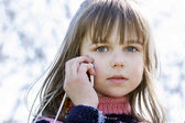 Adorable little girl talking by cellphone — Stockfoto