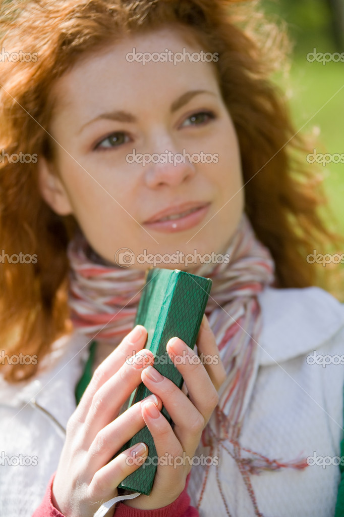 Beautiful young woman holding a book — Stock Photo #10174948