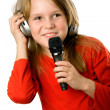 Pretty little girl with microphone and headphones — Stock fotografie