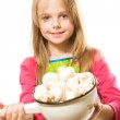 Pretty little girl holding metal pot with mushrooms — Stock Photo