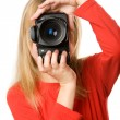 Pretty little girl with photo camera — 图库照片