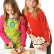 Stock Photo: Two little girls slicing mushrooms