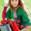 Stock Photo: Beautiful woman with shopping bags and tulips