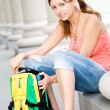 College girl opening backpack — Stock Photo