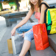 Young girl with shopping bags — Stock fotografie