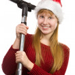 Smiling teen girl in santhat with vacuum cleaner broom — Stock Photo #10185172