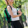 Young college student with backpack and books — Stock Photo