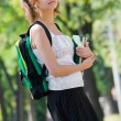Royalty-Free Stock Photo: Young college student with backpack and books