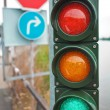 Stock Photo: Traffic lights with road signs