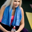 Beautiful young blonde in fitness club — Stock Photo #10185280