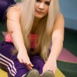 Stock Photo: Pretty blond girl stretching