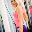 Young blonde in gym — Stock Photo