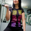 Stock Photo: Young smiling woman with a dumbbell