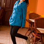 Fashionable elegant brunette in cafe — Stock Photo