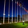 International flags next to european council building in Strasbo - Stock Photo