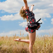 Happy beautiful girl jumping into the air — Stock Photo