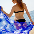 Beautiful woman with blue sarong — Stock Photo
