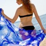 Beautiful woman with blue sarong — Stock Photo #10185812