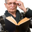 Elderly man reading a book — Stock Photo #10185835