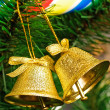 Golden bells on christmas tree — Stockfoto