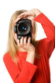 Pretty little girl with photo camera — Stock Photo