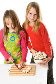 Two little girls slicing mushrooms — Stock Photo