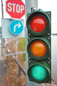 Traffic lights with road signs — Stock Photo