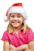 радостная девушка в шляпе санта — Стоковое фото