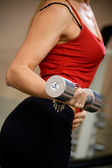 Woman exercising with dumbbell — Stock Photo