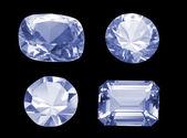 Cuatro diferentes en forma de diamantes aislados sobre negro — Foto de Stock