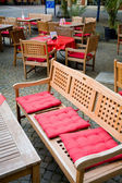 Wooden furniture in european street cafe — Stock Photo