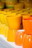 Yellow and orange ceramic cups — Stock Photo