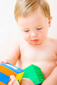 Cute little boy with cubes toy — Stock Photo