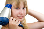Blond model with hairdryer — Stock Photo