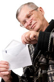 Elderly man opening letter envelope — Stock Photo