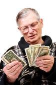 Happy old man holding dollars — Stock Photo