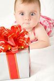 Reaching for gift box — Stockfoto