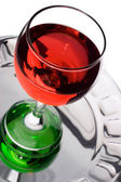 Wineglass filled with red liquid — Stock Photo